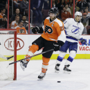 Philadelphia Flyers' Claude Giroux (28) breaks his stick on the goal after Tampa Bay Lightning's Valtteri Filppula (51), of Finland, scored an empty-net goal during the third period of an NHL hockey game, Tuesday, Dec. 16, 2014, in Philadelphia. Tampa Bay