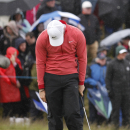 Northern Ireland's Rory McIlroy reacts after missing a putt on hole 18 during round one of the Irish Open Golf Championship at Royal County Down, Newcastle, Northern Ireland, Thursday, May 28, 2015. (AP Photo/Peter Morrison)