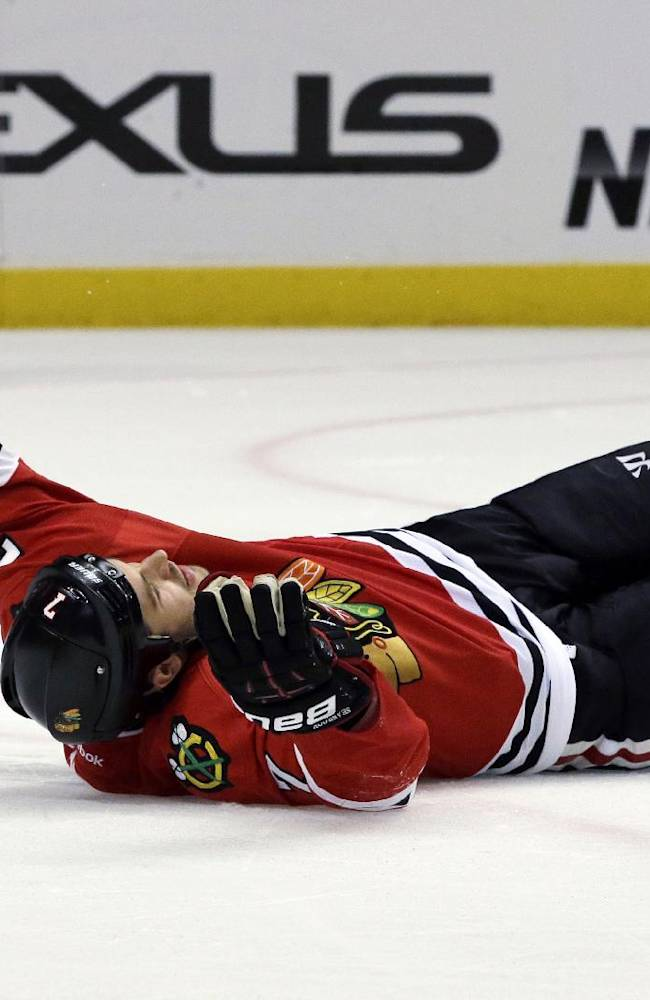 Chicago Blackhawks' Brent Seabrook (7) celebrates after scoring a goal during the second period of an NHL hockey game against the Washington Capitals, Tuesday, Oct. 1, 2013, in Chicago
