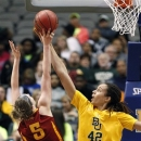 Iowa State forward Hallie Christofferson (5) has her shot blocked by Baylor center Brittney Griner (42) in the first half of their NCAA college basketball championship game in the Big 12 Conference tournament, Monday, March 11, 2013, in Dallas. (AP Photo/Tony Gutierrez)