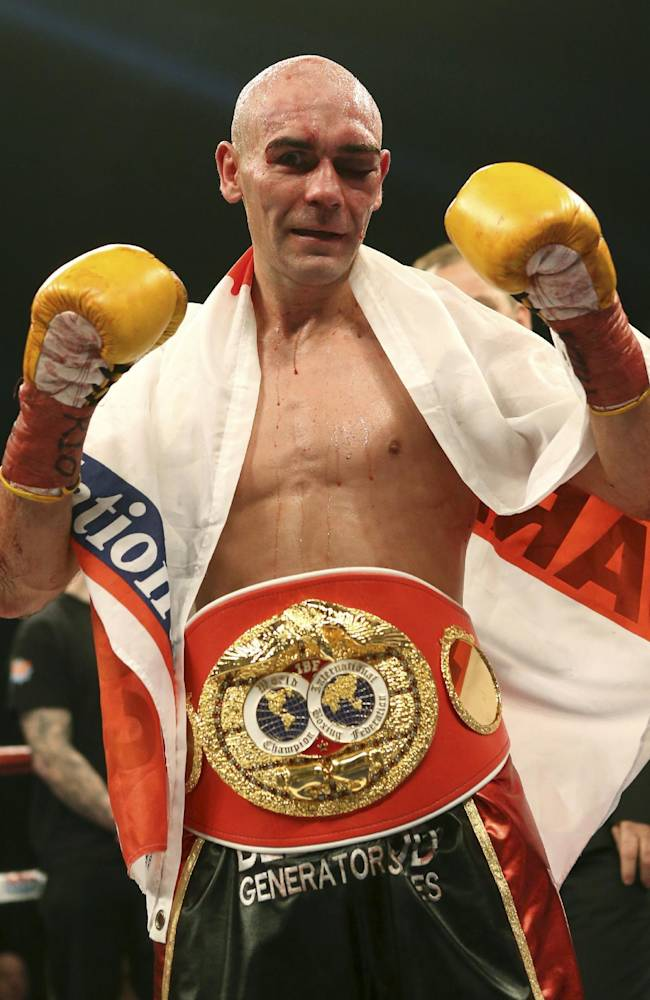 Britain's Stuart Hall poses with his belt after winning his IBF bantamweight title fight against South Africa's Vusi Malinga at the First Direct Arena, in Leeds, England, Saturday Dec. 21, 2013. Hall claimed the vacant IBF bantamweight title on Sunday after a points win over Malinga