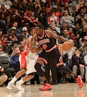 TORONTO, CANADA - November 15: Luol Deng #9 of the Chicago Bulls drives against Kyle Lowry #7 of the Toronto Raptors on November 15, 2013 at the Air Canada Centre in Toronto, Ontario, Canada. (Photo by Ron Turenne/NBAE via Getty Images)