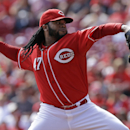Cincinnati Reds starting pitcher Johnny Cueto throws against the Pittsburgh Pirates in the firstinning of a baseball game, Sunday, Sept. 28, 2014, in Cincinnati. (AP Photo/Al Behrman)