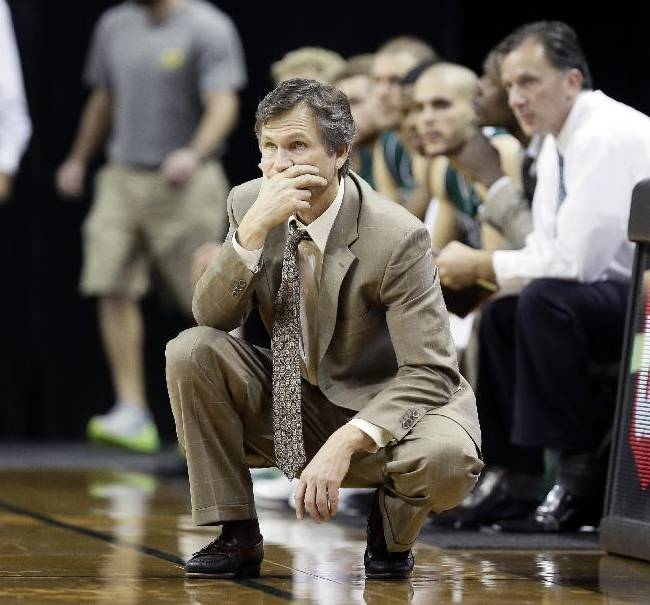 Utah Valley coach Dick Hunsaker watches from the bench during the second half of an NCAA college basketball game against Oregon  in Eugene, Ore., Tuesday, Nov. 19, 2013. Oregon beat Utah Valley 69-54