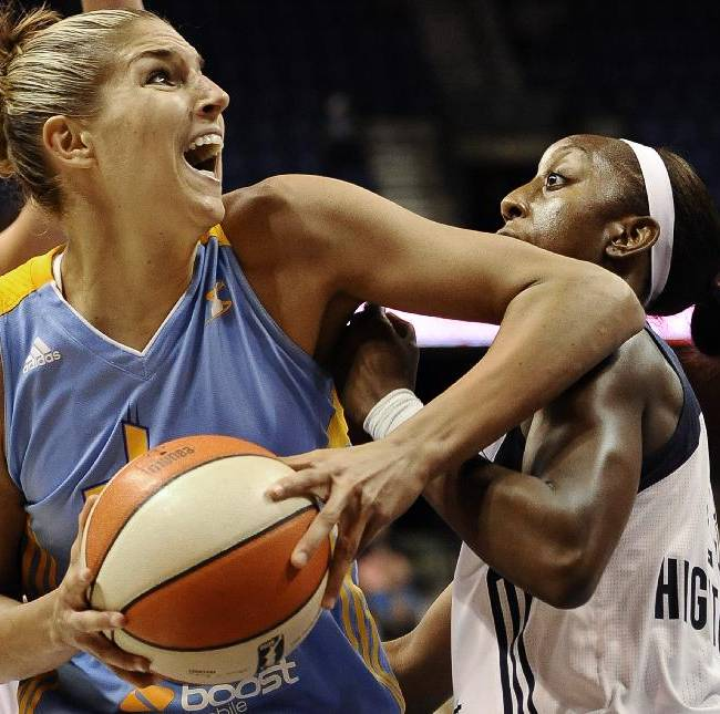 In this Aug. 9, 2013, file photo, Chicago Sky's Elena Delle Donne, left, is guarded by Connecticut Sun's Allison Hightower during the first half of a WNBA basketball game in Uncasville, Conn. Delle Donne led Chicago to its first postseason berth in franchise history and hopes to help the Sky defeat defending WNBA champion, Indiana Fever, in the opening round