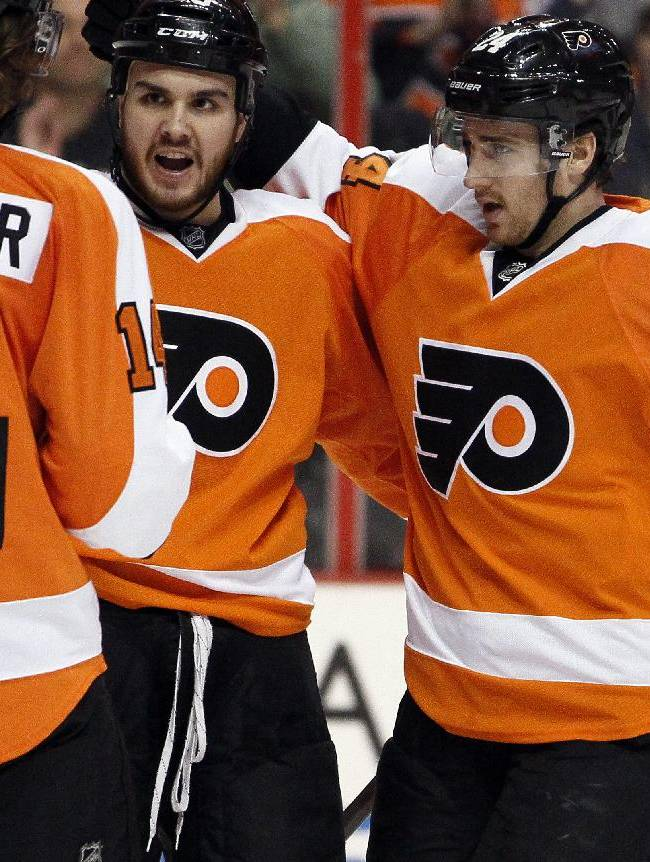 Philadelphia Flyers' Sean Couturier, Zac Rinaldo and Matt Read, from left, celebrate Rinaldo's goal during the second period of an NHL hockey game against the Buffalo Sabres, Sunday, April 6, 2014, in Philadelphia. Rinaldo was ejected in the third period, incurring a match penalty for a hit to the head of Chad Ruhwedel. The Flyers won 5-2