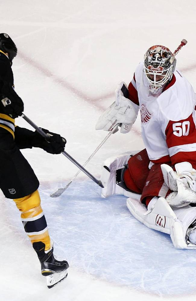 Boston Bruins' Milan Lucic (17) scores past Detroit Red Wings' Jonas Gustavsson (50) during the third period in Game 5 in the first round of the NHL hockey Stanley Cup playoffs  in Boston, Saturday, April 26, 2014