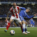 Chelsea's Fernando Torres, right, competes with Stoke City's Andy Wilkinson during their English Premier League soccer match at Stamford Bridge, London, Saturday, April 5, 2014