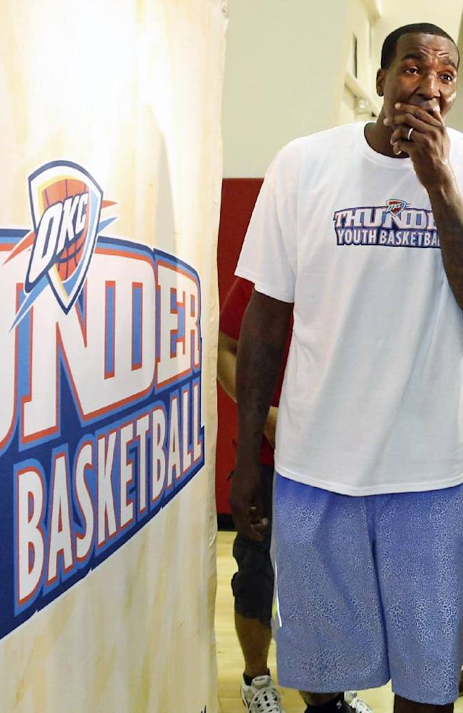 Oklahoma City Thunder NBA player Kendrick Perkins prepares to speak to reporters following an appearance at a youth basketball clinic in Oklahoma City, Wednesday, June 19, 2013