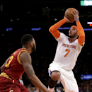 New York Knicks' Carmelo Anthony, right, sinks a basket over Cleveland Cavaliers' Alonzo Gee during the first half of an NBA basketball game at Madison Square Garden, Sunday, March 23, 2014, in New York The Associated Press