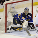 St. Louis Blues' goalie Ryan Miller (39) blocks a shot by Chicago Blackhawks' Nick Leddy (8) during the second period in Game 2 of a first-round NHL hockey playoff series on Saturday, April 19, 2014, in St. Louis The Associated Press