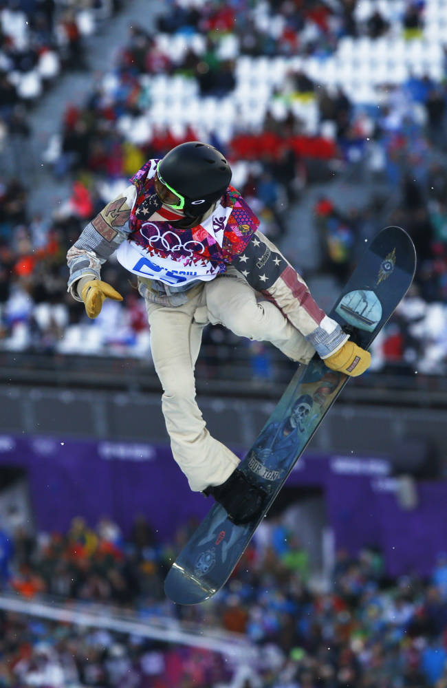 Shaun White of the United States competes during the men's snowboard halfpipe qualifying session at the Rosa Khutor Extreme Park, at the 2014 Winter Olympics, Tuesday, Feb. 11, 2014, in Krasnaya Polyana, Russia. (AP Photo/Sergei Grits)