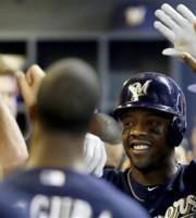Milwaukee Brewers' Rickie Weeks high-fives teammates in the dugout after his two-run home run against the San Diego Padres during the fifth inning of a baseball game, Monday, Oct. 1, 2012, in Milwaukee. (AP Photo/Jeffrey Phelps)