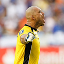 El Salvaldor goalkeeper Dagoberto Portillo celebrates as the final whistle is blown during the second half of a CONCACAF Gold Cup soccer match on Monday, July 15, 2013, in Houston. El Salvador won 1-0. (AP Photo/Bob Levey)