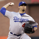 Los Angeles Dodgers starting pitcher Josh Beckett throws to the San Francisco Giants during the first inning of a baseball game Tuesday, April 15, 2014, in San Francisco The Associated Press