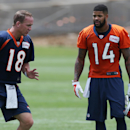 Denver Broncos quarterback Peyton Manning, left, confers with rookie wide receiver Cody Latimer after the Broncos' morning session at the team's NFL football training camp in Englewood, Colo., Friday, July 25, 2014. (AP Photo) The Associated Press