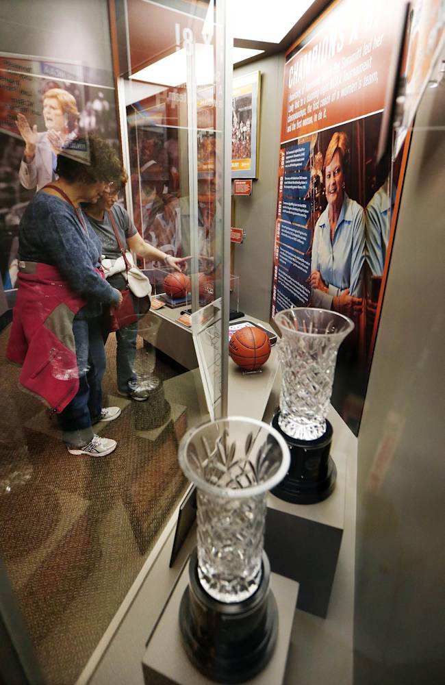 Trophies and other items are displayed in the Pat Summitt Gallery at the Tennessee Sports Hall of Fame on the opening day of the exhibit Friday, April 4, 2014, in Nashville, Tenn. The exhibit, located in Bridgestone Arena, features memorabilia, photos, videos and interactive displays highlighting the former Tennessee women's NCAA college basketball coach