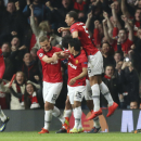 Manchester United's Nemanja Vidic, second left, celebrates with his teammates after scoring the opening goal during the Champions League quarterfinal first leg soccer match between Manchester United and Bayern Munich at Old Trafford Stadium, Manchester, E