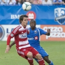 FC Dallas' Conor Shanosky left, battles Montreal Impact's Sanna Nyassi, right, for possession of the ball during first-half MLS soccer game action in Montreal, Saturday, July 20, 2013. (AP Photo/The Canadian Press, Peter McCabe)