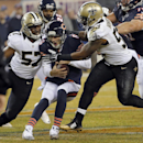 Chicago Bears quarterback Jay Cutler (6) is sacked by New Orleans Saints inside linebackers David Hawthorne (57) and Ramon Humber (53) during the first half of an NFL football game Monday, Dec. 15, 2014, in Chicago The Associated Press