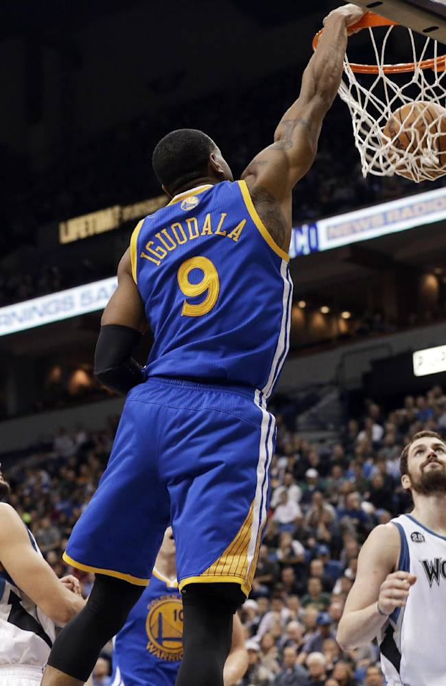 Golden State Warriors' Andre Iguodala (9) dunks between Minnesota Timberwolves' Ricky Rubio, left, of Spain and Kevin Love during the second half of an NBA basketball game, Wednesday, Nov. 6, 2013, in Minneapolis. The Warriors won 106-93