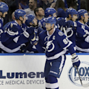 Tampa Bay Lightning center Steven Stamkos (91) celebrates his goal against the Buffalo Sabres with teammates during the third period of an NHL hockey game Friday, Jan. 9, 2015, in Tampa, Fla. The Lightning won 2-1 The Associated Press