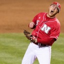 In this March 27, 2015, photo, Nebraska relief pitcher Colton Howell (25) reacts after striking out Texas batter Ben Johnson for the third out in the eighth inning of a college baseball game in Lincoln, Neb. Big Ten baseball is on the rise. Nebraska swept nationally ranked Texas this past weekend and has won 14 of its last 15 games. (AP Photo/Lincoln Journal-Star, Francis Gardler)