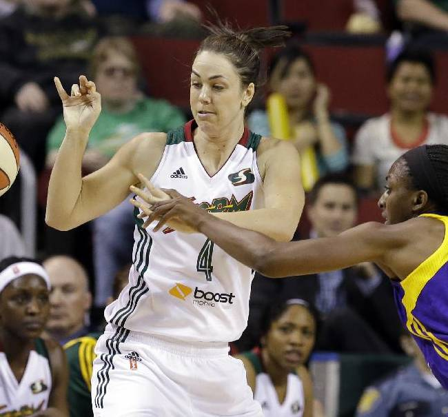 Los Angeles Sparks' Nneka Ogwumike, right, knocks the ball away from Seattle Storm's Jenna O'Hea in the first half of a WNBA basketball game Friday, May 16, 2014, in Seattle