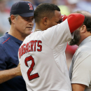 Boston Red Sox Xander Bogaerts (2) is tended to by manager John Farrell, left, and a trainer after being hit by a pitch in the left wrist during the second inning of a baseball game against the Texas Rangers, Thursday, May 28, 2015, in Arlington, Texas. (AP Photo/Brandon Wade)