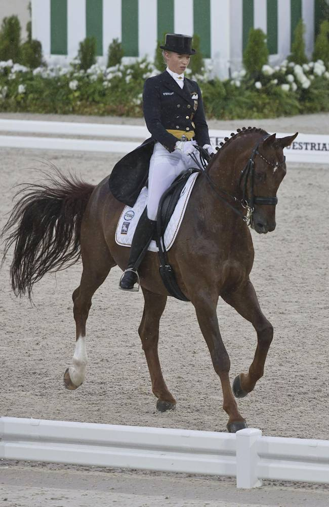 Fabienne Lutkemeier of Germany, riding during the first day of Dressage team competition at the FEI World Equestrian Games, at Michel d'Ornano stadium in Cean, western France, Monday, Aug. 25, 2014