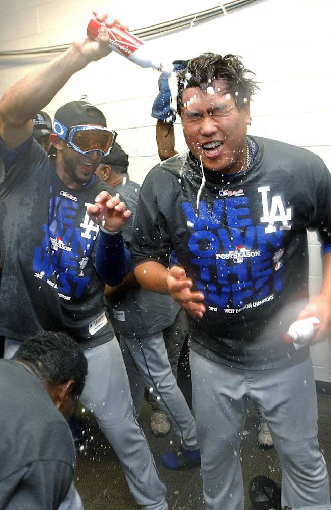 Los Angeles Dodgers' Hyun-Jin Ryu, of South Korea, right, and teammates celebrate after the Dodgers clinched the NL West title with a 7-6 win over the Arizona Diamondbacks in a baseball game, Thursday, Sept. 19, 2013, in Phoenix