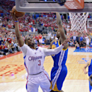Los Angeles Clippers guard Chris Paul, left, puts up a shot as Golden State Warriors forward Harrison Barnes defends during the second half in Game 1 of an opening-round NBA basketball playoff series, Saturday, April 19, 2014, in Los Angeles. The Warriors