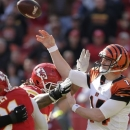 Cincinnati Bengals quarterback Andy Dalton (14) passes under pressure from Kansas City Chiefs nose tackle Dontari Poe during the first quarter of a an NFL football game Sunday, November 18, 2012, in Kansas City, Mo. (AP Photo/Charlie Riedel)