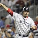 FILE - In this July 29, 2012 file photo, Boston Red Sox's Adrian Gonzalez gestures after scoring during a baseball game against the New York Yankees at Yankee Stadium in New York. The Red Sox have traded Gonzalez, pitcher Josh Beckett and outfielder Carl Crawford to the Los Angeles Dodgers in a nine-player deal. The trade was officially announced on Saturday, Aug. 25, 2012. The nine-player swap is the largest for the Dodgers since they moved to Los Angeles. (AP Photo/Seth Wenig, File)
