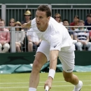 Kenny De Schepper of France returns to Juan Monaco of Argentina during their Men's singles match at the All England Lawn Tennis Championships in Wimbledon, London, Saturday, June 29, 2013. (AP Photo/Alastair Grant)