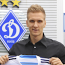 Poland interntional soccer team forward Lukasz Teodorczyk, and former of Lech Poznan player, holds a shirt of his new team at Lobanovskiy stadium after he signed a five year contract for FC Dynamo Kyiv in Kiev, Ukraine, Wednesday, 27 Aug., 2014. (AP phot
