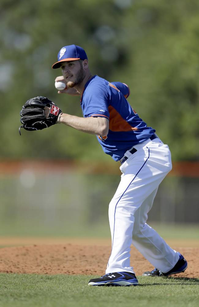 New York Mets pitcher Zack Wheeler throws home during spring training baseball practice Wednesday, Feb. 19, 2014, in Port St. Lucie, Fla