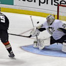 Anaheim Ducks center Ryan Getzlaf (15) misses wide of the goal against Pittsburgh Penguins goalie Marc-Andre Fleury (29) in a shootout in an NHL hockey game in Anaheim, Calif., Friday, March 7, 2014. The Penguins won the shootout, 3-2 The Associated Pres