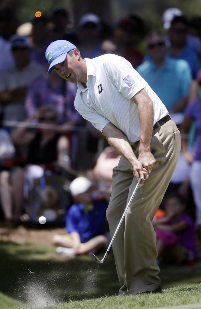 Matt Kuchar chips onto the eighth green during the second round of The Players championship golf tournament at TPC Sawgrass, Friday, May 9, 2014, in Ponte Vedra Beach, Fla