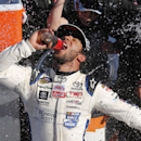 Darrell Wallace Jr., celebrates after winning the NASCAR Truck Series auto race in victory lane at Martinsville Speedway in Martinsville, Va., Saturday, Oct. 25, 2014. (AP Photo/Steve Helber)