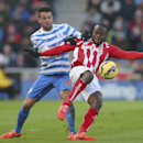 Queens Park Rangers' Mauricio Isla, left, challenges Stoke City's Victor Moses during their English Premier League soccer match at The Britannia Stadium, Stoke-on-Trent, England, Saturday, Jan. 31, 2015