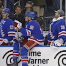 New York Rangers defenseman Ryan McDonagh (27), Rangers defenseman Marc Staal (18) and Rangers goalie Henrik Lundqvist (30) of Sweden react at the end of the third period of an NHL hockey game at Madison Square Garden in New York, Tuesday, Jan. 13, 2015 a