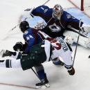 Minnesota Wild right wing Nino Niederreiter, front, of the Czech Republic, is sent flying by a check from Colorado Avalanche defenseman Ryan Wilson, center, as goalie Semyon Varlamov, of Russia, blocks a shot in the third period of the Wild's 3-0 victory