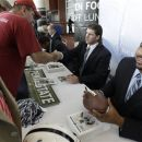 Penn State football players Michael Mauti and John Urschel, right, sign autographs for fans as part of Big Ten Media Days and Kickoff Luncheon, Friday, July 27, 2012, in Chicago. (AP Photo/M. Spencer Green)