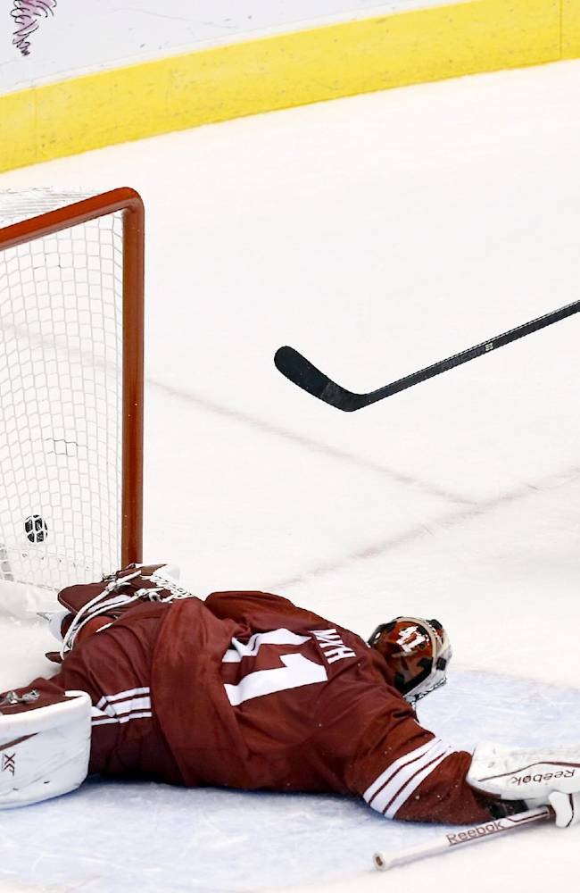 Phoenix Coyotes' Mike Smith makes a sprawling save on a shot by New York Rangers' J.T. Miller (10) in the third period during an NHL hockey game on Thursday, Oct. 3, 2013, in Glendale, Ariz.  The Coyotes defeated the Rangers 4-1