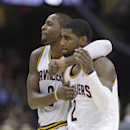 Cleveland Cavaliers' C.J. Miles, left, taps Kyrie Irving on the chest after Kyrie made the final basket during the second overtime against the Philadelphia 76ers in an NBA basketball game Saturday, Nov. 9, 2013, in Cleveland. The Cavaliers won 127-125 The