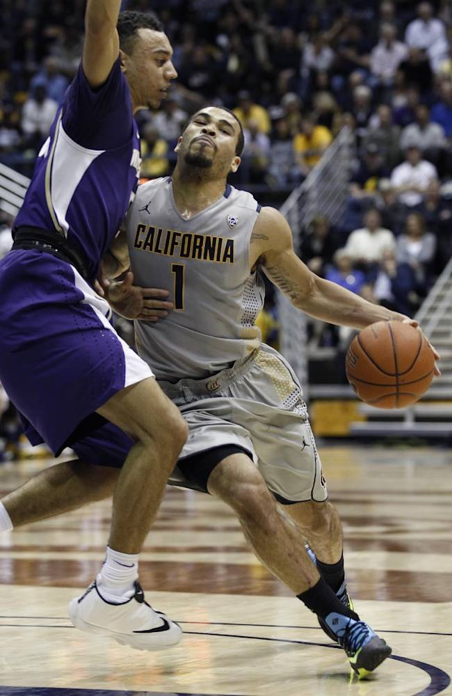 California's Justin Cobbs (1) drives for the basket past Washington's Nigel Williams-Goss during the first half of an NCAA college basketball game, Wednesday, Jan. 15, 2014, in Berkeley, Calif