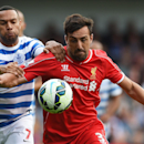Queens Park Rangers' Matt Phillips, left, competes for the ball with Liverpool's Jose Enrique during their English Premier League soccer match at Loftus Road, London, Sunday, Oct. 19, 2014