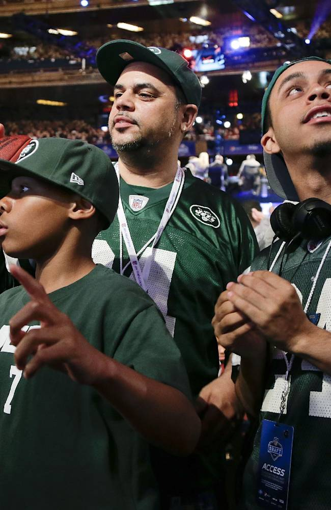 New York Jets fans listen for the Jets' fourth-round selection at the 2014 NFL Draft, Saturday, May 10, 2014, in New York. The Jets picked Oklahoma wide receiver Jalen Saunders