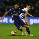 QPR's Yun Suk-Young, right, vies for the ball with Manchester City's Jesus Navas during the English Premier League soccer match between Queens Park Rangers and Manchester City at Loftus Road stadium in London, Saturday, Nov. 8, 2014